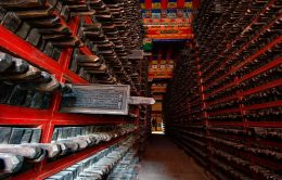 Dege Scripture Printing House, Dege, Sichuan, China - the library of carved wooden printing blocks. One floor of the library is taken up with the collection of woodblock sutras, stacked in shelves with their handles facing outwards. The official number of the collection is 270,000. The blocks are in three editions according to size, the longest being the 'arrow-stick' (60-70cm, the length of an arrow).